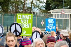 Protesters gather outside the main gate to the AWE, Aldermaston. Aldermaston, United Kingdom, 1st April 2018:- CND protesters gather outside the main gate to the royalty free stock image