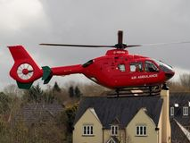 Aldermaston Wharf, Berkshire, UK, April 3 2018: Air Ambulance landing in housing estate to attend to an emergency Stock Photo