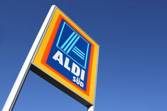 Aldi sign against blue sky. South division - Aldi is a leading global discount supermarket chain with almost 10,000 stores in 18 countries Royalty Free Stock Photography