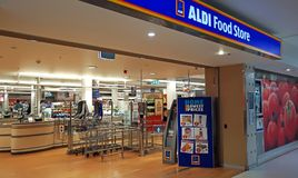 Aldi supermarket entrance interior in Edgecliff. Aldi is a large German discount supermarket chain. Sydney, Australia - November 13, 2017: Aldi supermarket stock image