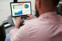 Мale freelancer analyzing performance Stock Photos