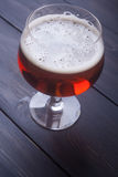 Ale on wood Stock Photography