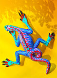 Alebrije on Yellow Background With Shadow stock photo