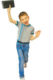 Alegría del muchacho con la tableta Imágenes de archivo libres de regalías