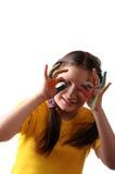 Alegría. Muchacha del preadolescente que juega con colores Foto de archivo