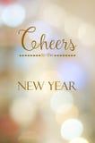 Alegrías al Año Nuevo en fondo abstracto del bokeh de la falta de definición Foto de archivo libre de regalías