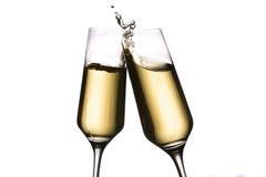 Alegrías con los vidrios del champán Imagen de archivo libre de regalías