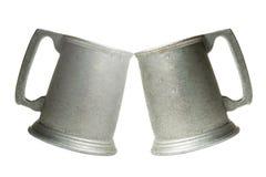 Alegrías, tazas viejas del metal Imagenes de archivo