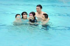 Alegre en piscina Imagen de archivo libre de regalías