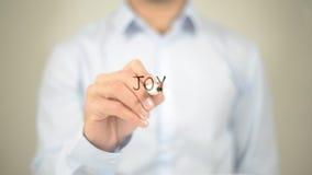 Alegria, escrita do homem na tela transparente Fotografia de Stock