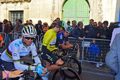 World Champion Alejandro Valverde Shakes in The Streets Of Alicante. Alejandro Valverde wearing the rainbow shirt of the World champion, waits in the narrow stock image
