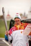 Aleksey Kolesnikov som bär den olympiska facklan, Kolomna, Ryssland Arkivfoton