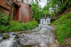 Aleksupite waterfall in Kuldiga. Aleksupite artificially modified waterfall at the old mill Royalty Free Stock Photography