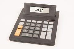 Alemán del interés de la calculadora Foto de archivo