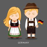 Alemães no vestido nacional com uma bandeira ilustração stock