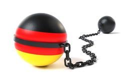 Alemanha amarrou a uma bola e a uma corrente imagens de stock