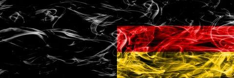 Alemanha contra as bandeiras do fumo de Alemanha do zzz colocadas de lado a lado Alemão a imagens de stock