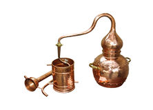 Alembic Copper. Distillation apparatus employed for the distillation of alcohol, essential oils and moonshine. Modern wine distillery for the home made of the stock images