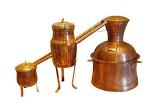 Alembic Copper - Distillation apparatus. Employed for the distillation of alcohol, essential oils and moonshine. Vintage wine distillery for the home made of stock photography