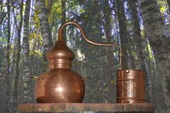 Alembic Copper. A distillation apparatus used for the production of alcohol, essential oils and moonshine. Isolate royalty free stock photo