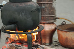 Alembic. Flames on foreground of an alembique stock photography