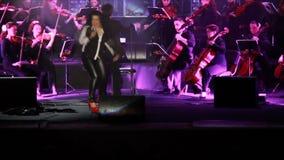Alena Lisnyak singing final You'd better stop by Sam Brown. KHARKIV, UKRAINE - FEBRUARY 14, 2015: Sympho-Show «World Hits» in Kharkiv National Opera and