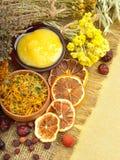 Сalendula flower, oats, immortelle flower, tansy herb, honey, w Royalty Free Stock Photography