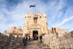 Aleppo, Syria, Visitors exit the gate of Aleppo citadel at the end of 2010 shortly before start of Syrian civil war Royalty Free Stock Images