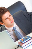 Alert businessman looking in corner. Close-up Royalty Free Stock Images