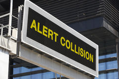 Alert collision signpost in the city with building facade backgr Royalty Free Stock Image