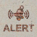 Alert Concept on the Wall. Alert Concept with Ringing Bell Icon on the Brick and Plastered Wall Stock Photos