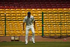 Alert fielder cricket. Alert fielder Pankaj Singh watches the ball during a game of cricket stock photo