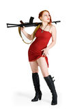 Alert girl. Alerted girl in red dress with a gun Stock Photography