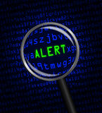 ALERT in green revealed in blue computer machine code. The word ALERT in green revealed in blue computer machine code through a magnifying glass Stock Images