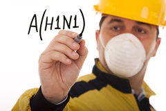 Alert for A(H1N1). Men writing a world alert for the swine influenza A(H1N1) (selective focus Stock Images