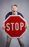 Alert man showing stop sign. Stock Images
