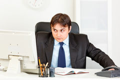 Alert modern businessman looking in corner Stock Image