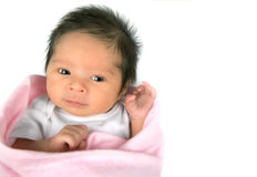 Alert Newborn Girl. An alert smiling newborn baby girl on a white background with copy space stock photography
