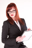 Alert and ready to go. A business woman writing notes prior to a meeting Royalty Free Stock Photo