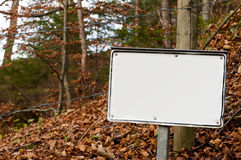 Alert sign for labeling in front of a barbed wire Stock Images