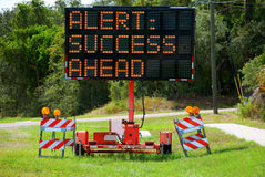Alert: Success Ahead Lighted Road Sign Royalty Free Stock Images