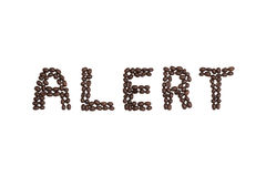 ALERT written with coffee beans Royalty Free Stock Images