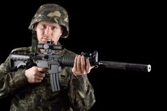 Alerted soldier holding m16. In studio. Closeup Stock Image