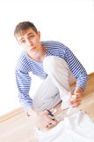Alerted young man. Alerted twenty year young man cutting a T-shirt Royalty Free Stock Photos