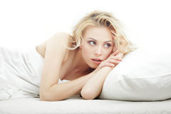 Alertness in the bedroom. Alert lady laying on the bed royalty free stock photo