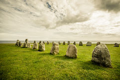 Ales stones in Skane, Sweden. Beautiful view of Ales stones, impressing archaeological megalithic monument in Skane, Sweden. Color toned Royalty Free Stock Photography