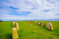 Ales stones in Skane, Sweden. SKANE, SWEDEN - JUNE 19, 2015: Unknown tourists visiting Ales stones, megalithic monument in Skane Stock Image