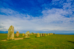 Ales stones in Skane, Sweden. SKANE, SWEDEN - JUNE 19, 2015: Unknown tourists visiting Ales stones, megalithic monument in Skane Stock Photography