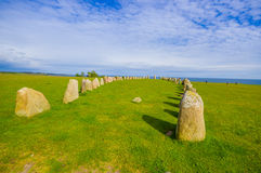 Ales stones in Skane, Sweden. SKANE, SWEDEN - JUNE 19, 2015: Unknown tourists visiting Ales stones, megalithic monument in Skane Stock Photo