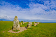 Ales stones in Skane, Sweden. SKANE, SWEDEN - JUNE 19, 2015: Unknown tourists visiting Ales stones, megalithic monument in Skane Stock Images